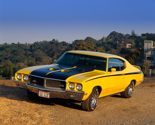 AUT 23 RK0113 08 © Kimball Stock 1970 Buick GSX Yellow And Black 3/4 Front View On Dirt