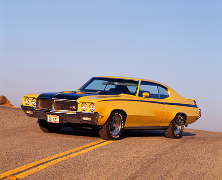 AUT 23 RK0114 02 © Kimball Stock 1970 Buick GSX Yellow And Black 3/4 Front View On Road Blue Sky