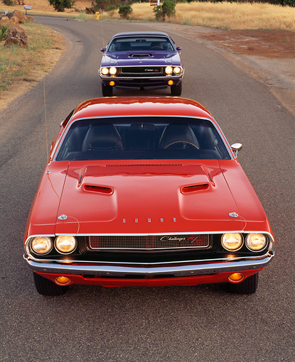 AUT 23 RK0156 06 © Kimball Stock 1970 Dodge Hemi Challenger Orange And Plum Crazy Overhead Head On Shot On Pavement