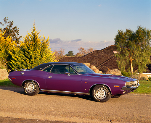 AUT 23 RK0166 01 © Kimball Stock 1970 Dodge Challenger Plum Crazy 3/4 Side View On Pavement By Trees Blue Sky