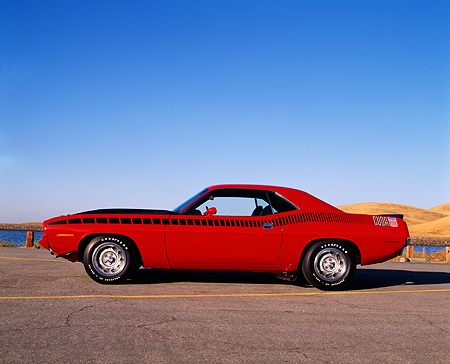 AUT 23 RK0175 03 © Kimball Stock 1970 Plymouth AAR Barracuda Red And Black Profile On Pavement Blue Sky
