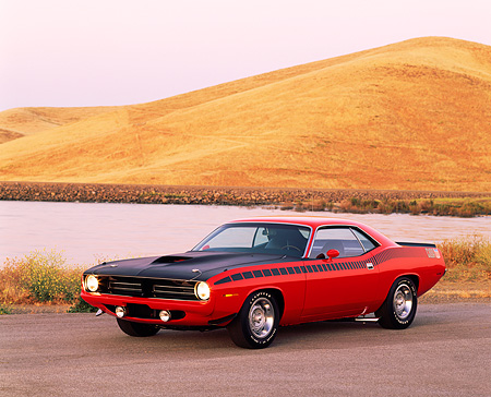 AUT 23 RK0176 09 © Kimball Stock 1970 Plymouth AAR Barracuda Red And Black 3/4 Front View On Pavement By Water