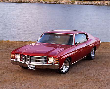 AUT 23 RK0186 01 © Kimball Stock 1971 Chevrolet Chevelle Red Front 3/4 Front View On Pavement By Water