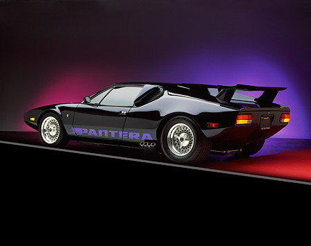 AUT 23 RK0201 01 © Kimball Stock 1971 De Tomaso Pantera Black 3/4 Rear View On Red Floor Studio