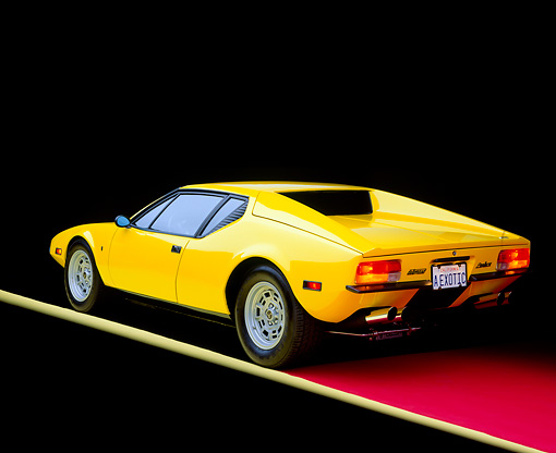 AUT 23 RK0232 02 © Kimball Stock 1972 De Tomaso Pantera Yellow 3/4 Rear View On Red Floor Yellow Line Studio