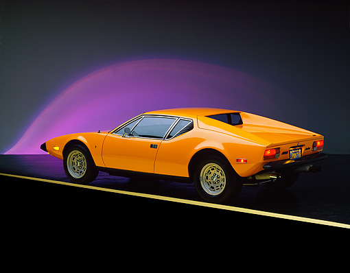 AUT 23 RK0258 01 © Kimball Stock 1973 De Tomaso Pantera Orange 3/4 Rear View On Yellow Line Purple Lighting Studio