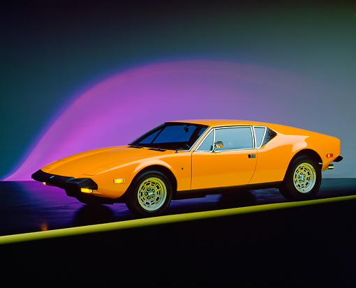 AUT 23 RK0261 01 © Kimball Stock 1973 De Tomaso Pantera Orange 3/4 Side View On Yellow Line Purple Lighting Studio