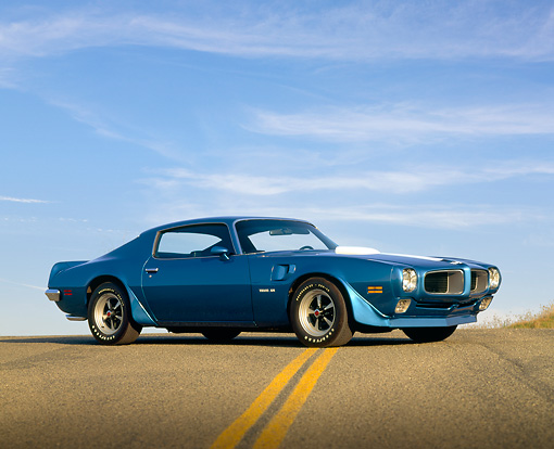 AUT 23 RK0278 01 © Kimball Stock 1970 Pontiac Firebird Trans Am Blue Low 3/4 Side View On Pavement Hill Blue Sky
