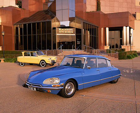 AUT 23 RK0343 08 © Kimball Stock 1970 Citroen DS 21 Blue 1963 Citroen Ami Yellow On Pavement By Museum