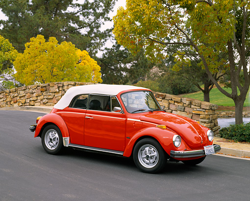 AUT 23 RK0400 01 © Kimball Stock 1979 Volkswagen Bug Convertible Red 3/4 Side View On Pavement By Bridge And Trees