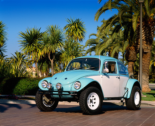 AUT 23 RK0406 01 © Kimball Stock 1970 VW Baja Bug Light Blue And White 3/4 Front View On Pavement By Palm Trees Blue Sky