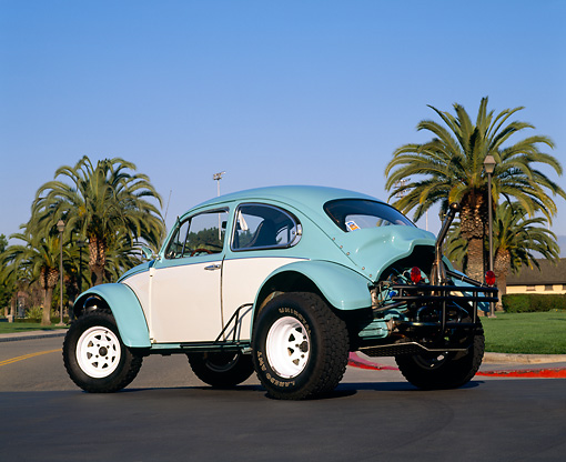 AUT 23 RK0410 05 © Kimball Stock 1970 VW Baja Bug Light Blue And White 3/4 Rear View On Pavement By Palm Trees Blue Sky