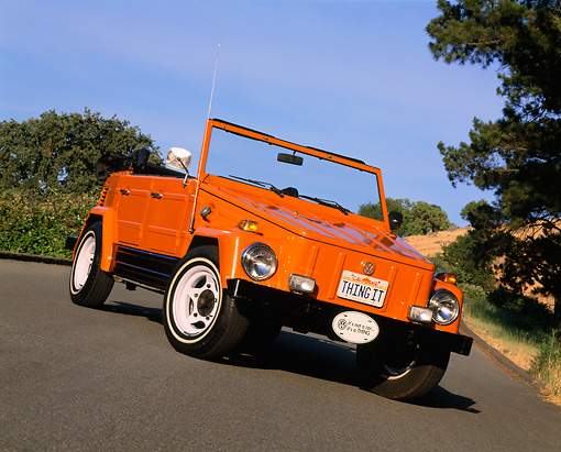 AUT 23 RK0445 01 © Kimball Stock 1973 Volkswagen Thing Type 181 Orange Slanted 3/4 Front View On Pavement By Trees