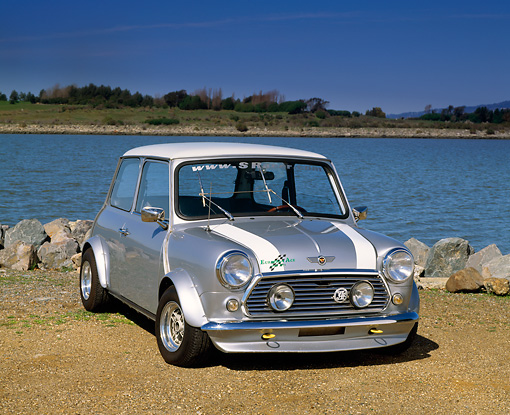 AUT 23 RK0484 01 © Kimball Stock 1973 Austin Mini Cooper Modified Silver White Stripe Front 3/4 View On Dirt