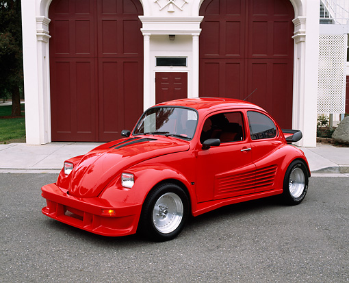 AUT 23 RK0511 01 © Kimball Stock 1974 Volkswagen Beetle Custom Red 3/4 Side View On Pavement By Firestation