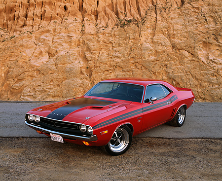 AUT 23 RK0524 01 © Kimball Stock 1971 Dodge Challenger 426 Hemi Red And Black 3/4 Front View Against Rock