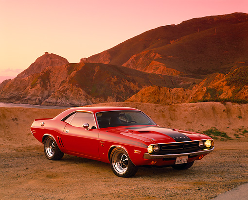 AUT 23 RK0528 04 © Kimball Stock 1971 Dodge Challenger 426 Hemi Red And Black 3/4 Front View On Sand By Rocks