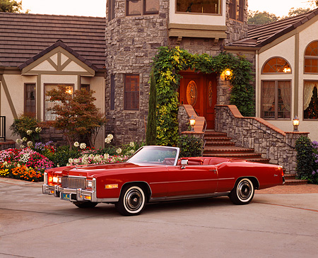 AUT 23 RK0619 03 © Kimball Stock 1976 Cadillac El Dorado Convertible Red 3/4 Side View On Driveway By House