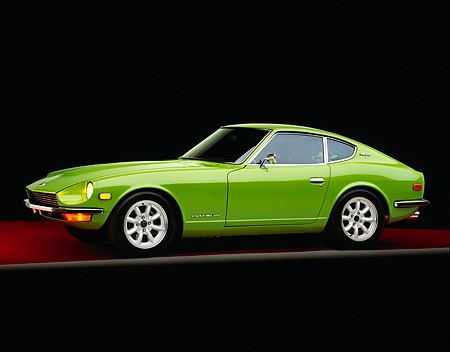 AUT 23 RK0703 05 © Kimball Stock 1970 Datsun 240Z Green 3/4 Side View On Red Floor Gray Line Studio