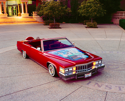 AUT 23 RK0779 01 © Kimball Stock 1977 Cadillac Coupe Deville  Convertible Red 3/4 Front View On Pavement
