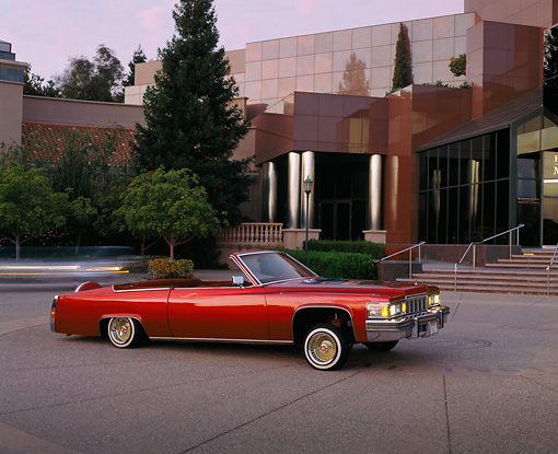 AUT 23 RK0780 01 © Kimball Stock 1977 Cadillac Coupe Deville Convertible Red 3/4 Side View By Museum