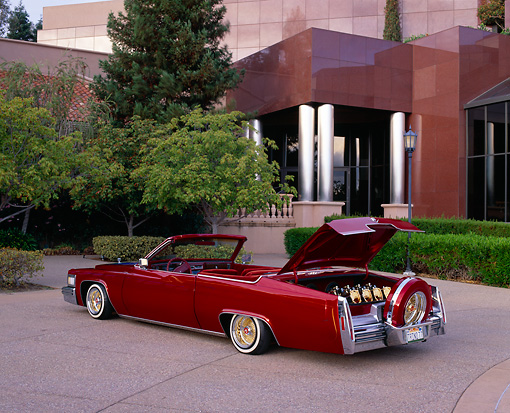 AUT 23 RK0784 01 © Kimball Stock 1977 Cadillac Coupe Deville Convertible Red 3/4 Rear View Trunk Open By Museum
