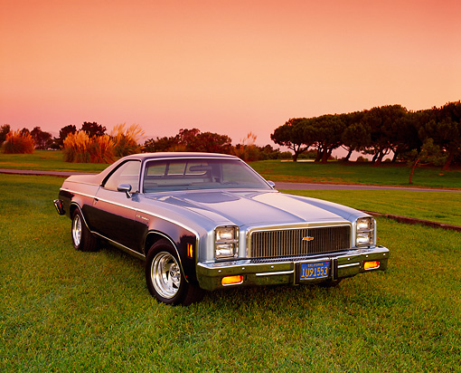 AUT 23 RK0796 03 © Kimball Stock 1977 Chevrolet El Camino Classic Two-Tone Blue 3/4 Front View On Grass By Trees Filtered