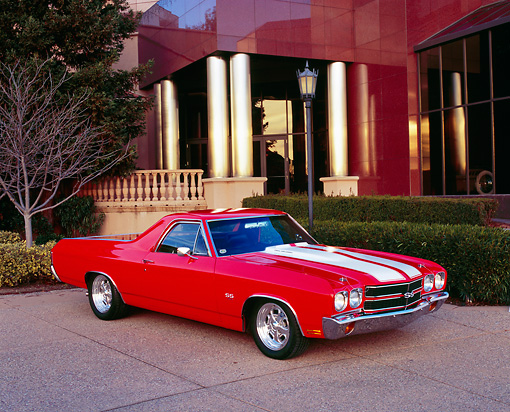 AUT 23 RK0807 01 © Kimball Stock 1970 Chevrolet El Camino SS 454 Red With White Stripes 3/4 Front View On Pavement By Museum