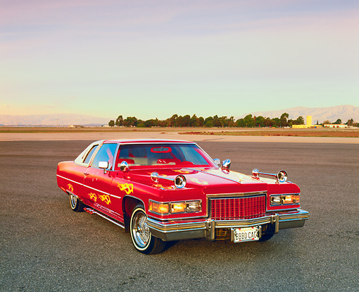 AUT 23 RK0824 01 © Kimball Stock 1976 Cadillac Coupe Deville Red And White 3/4 Front View On Pavement Filtered