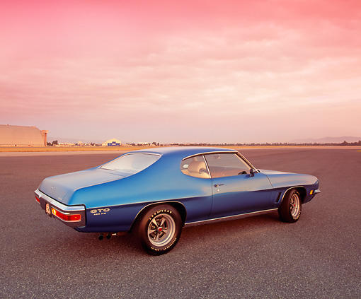 AUT 23 RK0847 01 © Kimball Stock 1972 Pontiac GTO 455 Blue Rear 3/4 View On Pavement Filtered