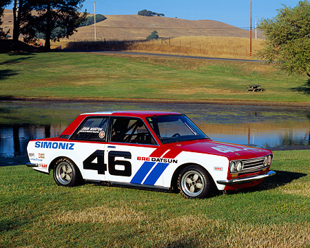 AUT 23 RK0864 03 © Kimball Stock 1971 Datsun BRE 510 Race Car 3/4 Front View On Grass By Water