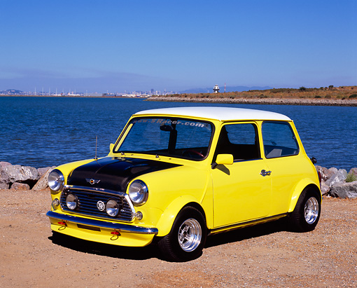AUT 23 RK0868 04 © Kimball Stock 1971 Austin Mini Cooper Racer Yellow 3/4 Front View On Dirt By Water