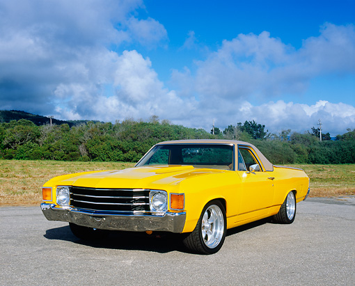 AUT 23 RK0897 05 © Kimball Stock 1972 Chevrolet El Camino Yellow 3/4 Front View On Pavement Blue Sky Clouds