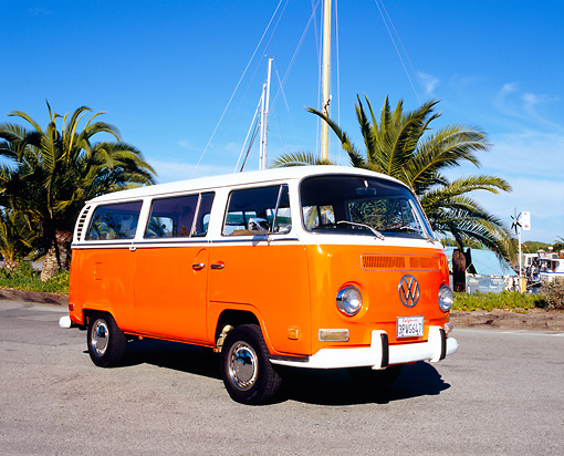 AUT 23 RK0961 01 © Kimball Stock 1971 Volkswagen Bus Orange And White 3/4 Front View On Pavement By Palm Trees
