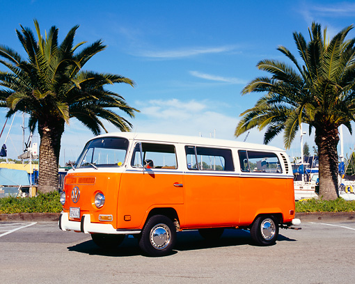 AUT 23 RK0963 01 © Kimball Stock 1971 Volkswagen Bus Orange And White 3/4 Front View On Pavement By Harbor