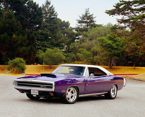 AUT 23 RK0978 04 © Kimball Stock 1970 Dodge Charger RT/SE Purple 3/4 Front View On Pavement By Trees