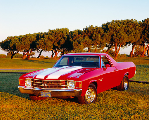 AUT 23 RK1013 03 © Kimball Stock 1972 Chevrolet, El Camino SS, Red White Stripe 3/4 Front View On Grass At Sunset