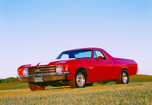 AUT 23 RK1016 03 © Kimball Stock 1972 Chevrolet, El Camino SS, Red White Stripe 3/4 Low Front View On Grass