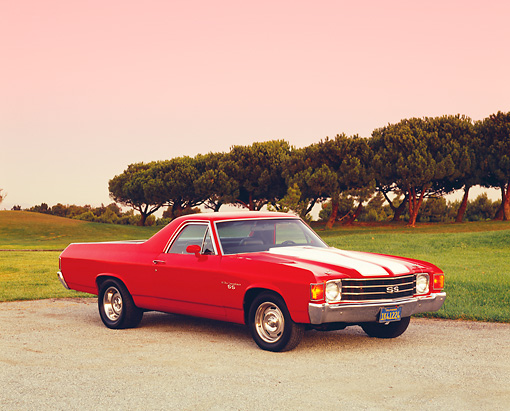 AUT 23 RK1018 05 © Kimball Stock 1972 Chevrolet, El Camino SS, Red White Stripe 3/4  Side View On Pavement By Grass And Trees At Sunset