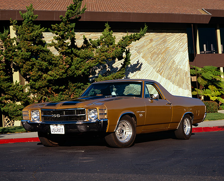 AUT 23 RK1029 02 © Kimball Stock 1971 Chevrolet, El Camino, SS 454, Gold 3/4 Front View On Pavement By Building