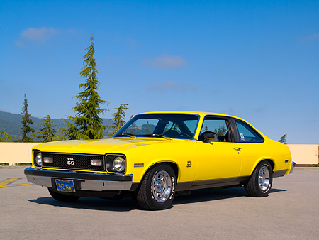 AUT 23 RK1033 01 © Kimball Stock 1976 Chevrolet Nova SS Yellow Low 3/4 Front View On Pavement