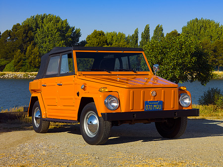 AUT 23 RK1051 01 © Kimball Stock 1974 Volkswagen Thing Type 181 Orange Low 3/4 Front View On Pavement By Water