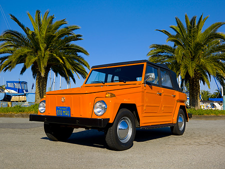 AUT 23 RK1053 01 © Kimball Stock 1974 Volkswagen Thing Type 181 Orange Low 3/4 Front View On Pavement By Harbor