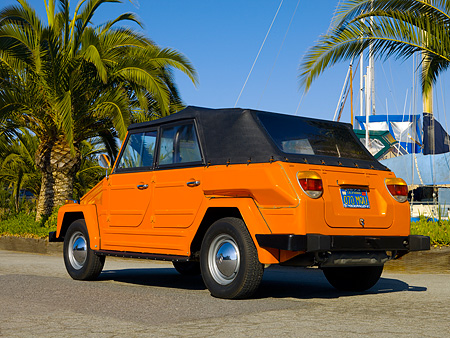 AUT 23 RK1054 01 © Kimball Stock 1974 Volkswagen Thing Type 181 Orange Low 3/4 Rear View On Pavement By Harbor