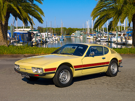 AUT 23 RK1063 01 © Kimball Stock 1974 Volkswagen SP2 Ivory Side 3/4 View On Pavement By Harbor