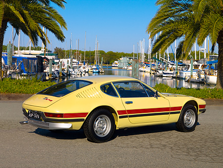 AUT 23 RK1064 01 © Kimball Stock 1974 Volkswagen SP2 Ivory Rear 3/4 View On Pavement By Harbor