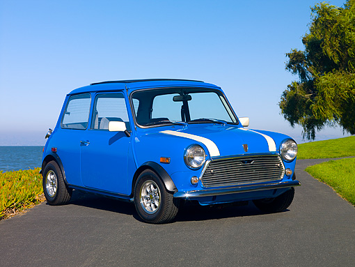 AUT 23 RK1093 01 © Kimball Stock 1979 Rover Mini Saloon Blue 3/4 Front View On Pavement By Water