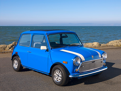 AUT 23 RK1094 01 © Kimball Stock 1979 Rover Mini Saloon Blue Front 3/4 View On Pavement By Water