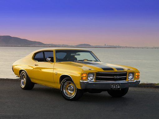 AUT 23 RK1172 01 © Kimball Stock 1971 Chevrolet Chevelle Yellow Black Strip 3/4 Front View On Pavement