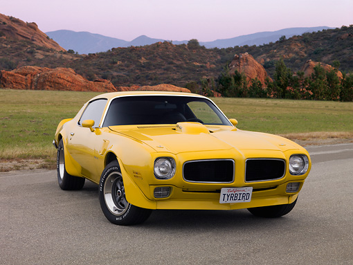 AUT 23 RK1174 01 © Kimball Stock 1971 Pontiac Firebird Trans Am Yellow Low 3/4 Front View On Pavement